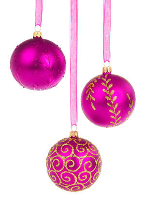 pink christmas: Three pink Christmas baubles hanging isolated on white background Stock Photo