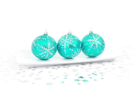 aqua baubles on a plate with stars on the background Stock Photo