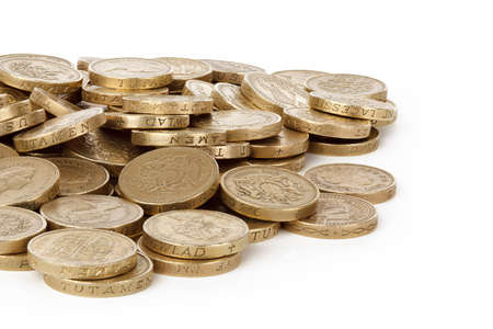 pile of british pounds isolated on white background Stock Photo