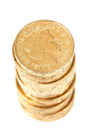 a stack of british one pound coins isolated on white background Stock Photo