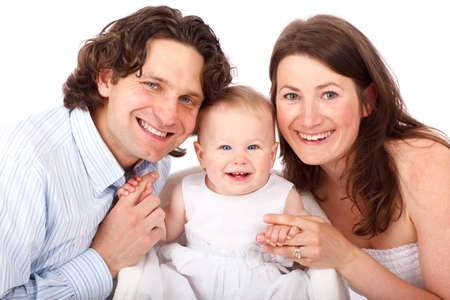 mom, dad and her baby girl smiling isolated on white background Stock Photo