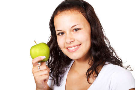 young woman holding green apple isolated on white background