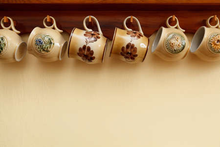 hanging ceramic cups in a row with some copyspace Stock Photo