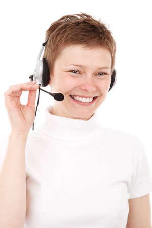 young woman with phone headset smiling isolated on white background - Jana Svojsova Stock Photo
