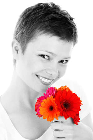 portrait of a young woman smiling with colorful flowers in her hand isolated on white background Stock Photo