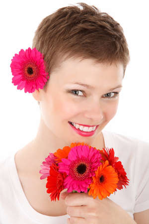 young woman wearing flowers in her hair isolated on white background Stock Photo