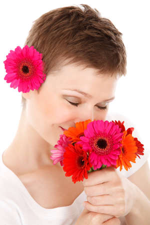 young woman smelling bouquet of colorful flowers isolated on white background