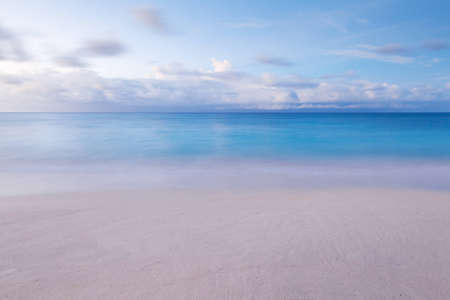 beach with blurred waves and sky in the morning