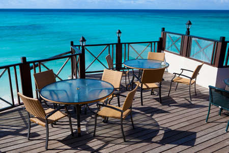 restaurant tables with a sea view Stock Photo