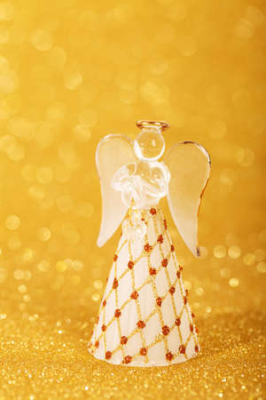 christmas angel decoration on a yellow golden background Stock Photo