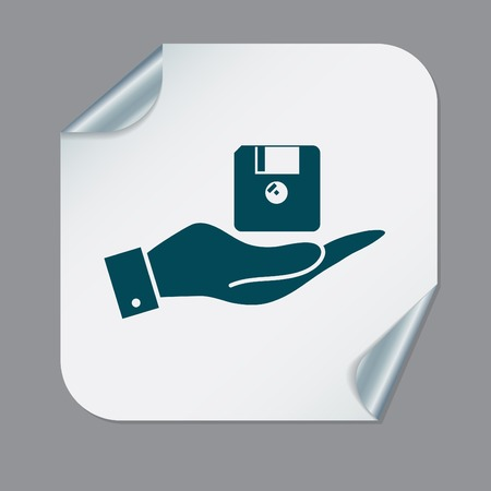 Floppy disk: hand holding a floppy, diskette. symbol store information document. computer floppy disk icon .