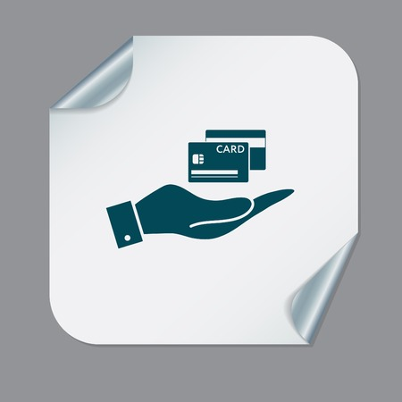 debt collection: hand holding a credit card.