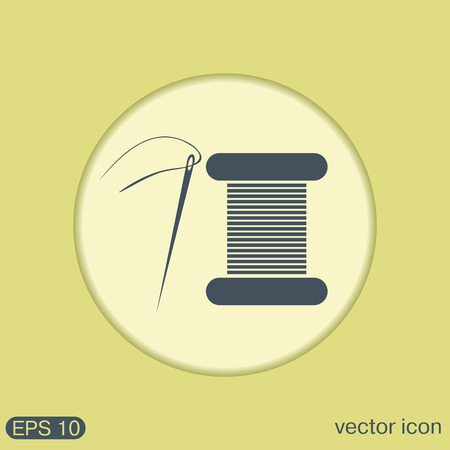 spool: spool of thread and needle. a symbol of fashion and sewing.