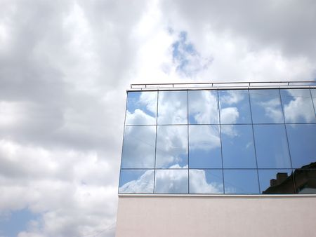 sky reflected on a building photo