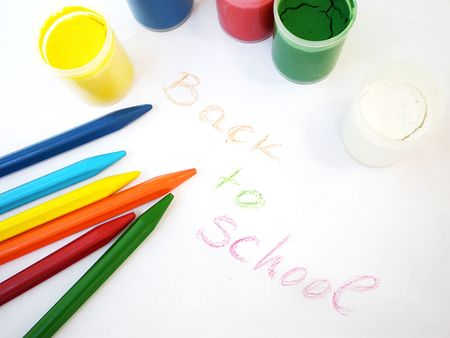 colorful crayons and water-colors, back to school concept photo