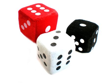 red, white and black dice isolated on white background photo