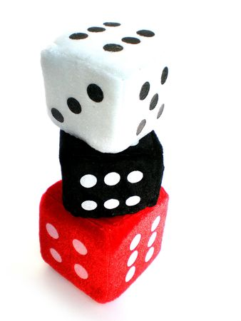 red, white and black dice up in a column photo
