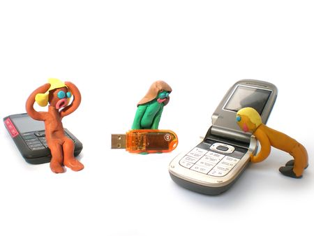 plasticine people figures with phones and usb flash on white background Stock Photo - 3755861