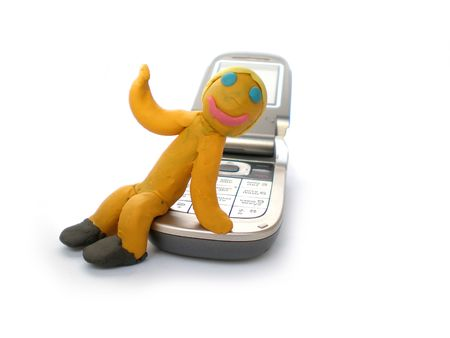 plasticine man figure with phone on white background photo