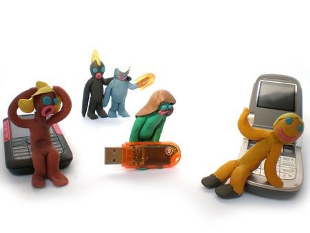 plasticine people figures with phones and usb flash on white background photo