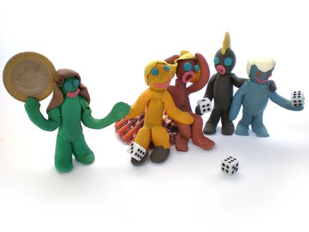plasticine people figures playing with dice on white background photo