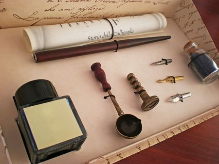 calligraphy ink pen set in a box on wooden table