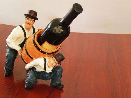 wine bottle holder with two men and cask Stock Photo - 3870848