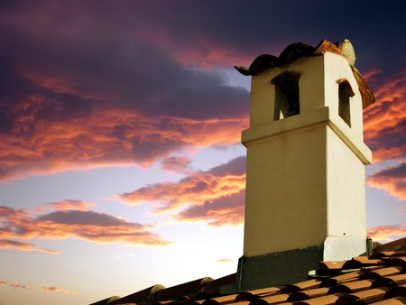rooftile: old style chimney against dramatic sky