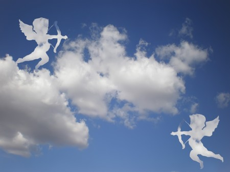 matchmaking: valentines day white cupids on cloudy sky Stock Photo