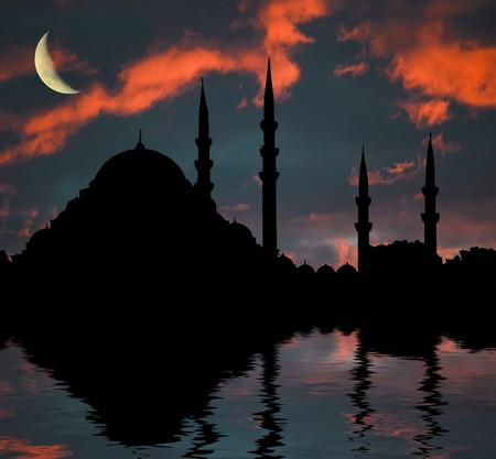 islam moon: islamic mosque at sunset in water ripples Stock Photo