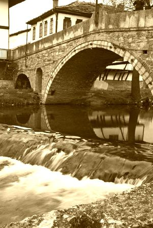 Tryavna - the bridge of sighes. old style historical city in North Bulgaria sepia photo