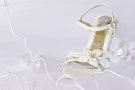 wedding sandals and flowers decoration over bridal veil Stock Photo - 4805723