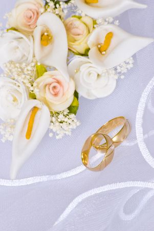 wedding rings and flowers decorations over bridal veil Stock Photo - 4805741