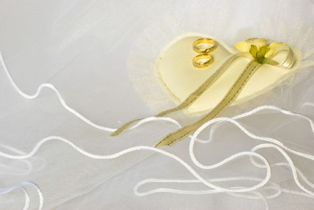 wedding golden rings over bridal veil Stock Photo - 4805753