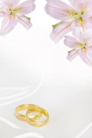 wedding band: wedding invitation or greeting card blank with lily flowers and golden rings