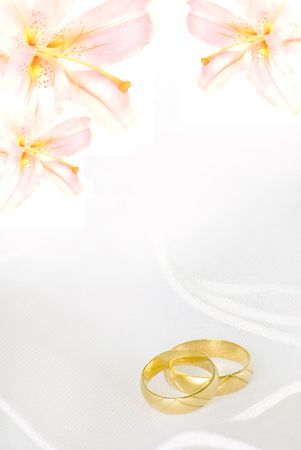 wedding invitation or greeting card blank with lily flowers and golden rings Stock Photo - 4836600