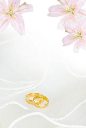 wedding invitation or greeting card blank with lily flowers and golden rings photo