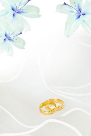 lilies: wedding invitation or greeting card blank with lily flowers and golden rings