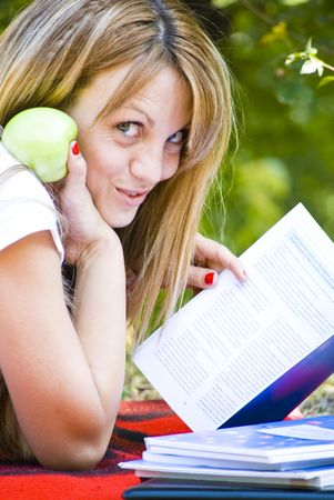 beautiful young woman working out with laptop and reading books Stock Photo - 5412756