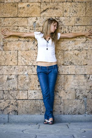 beautiful young model posing on wall Stock Photo - 5412773