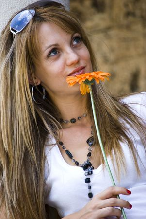 beautiful young blonde woman with flower photo