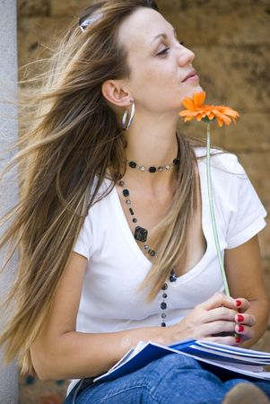 beautiful young woman with books and flower outdoor Stock Photo - 5412461