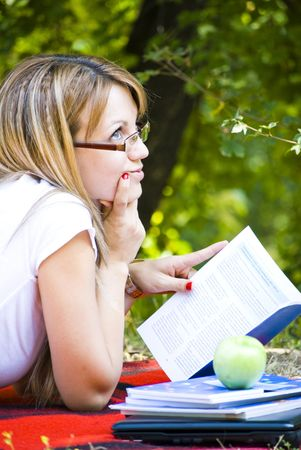 beautiful young woman working out with laptop and reading books Stock Photo - 5420820