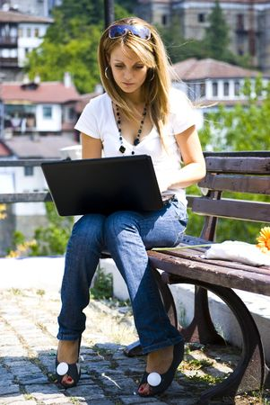 beautiful young woman working out with laptop or notebook photo