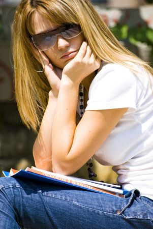 beautiful young woman reading book outdoor Stock Photo - 5489737