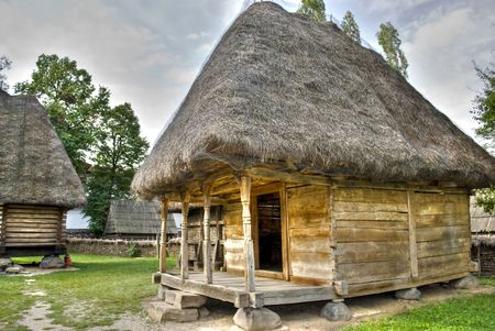 little wooden house in old Romanian village style photo