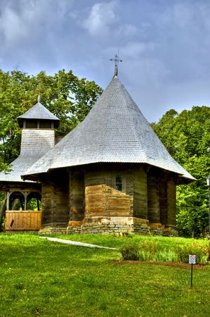 little wooden church in old Romanian village style photo