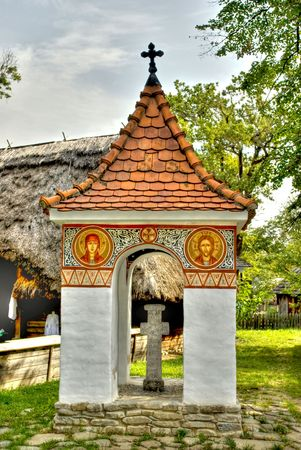monument in wooden village in old Romanian style photo