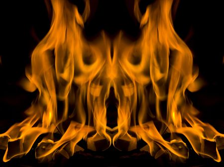 burning fire flames on a black background photo