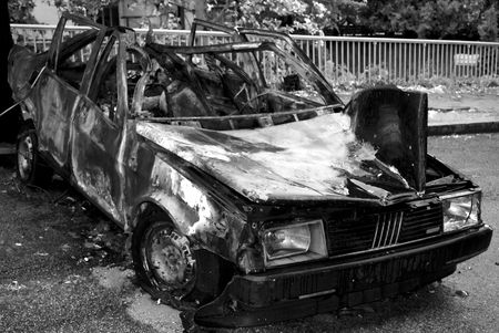 abandoned burnt rusted car - a terrorism act photo